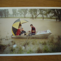 Eric and Carol Hannan travelling in a boat during floods, n.d.