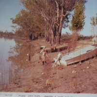Sue Wilksch on bank of Murray River, after floods, 1975