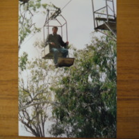 A man pictured on a cable car chair, n.d.