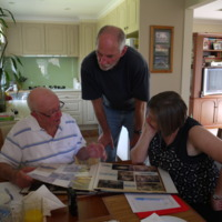 (L to R) Raymond Donald, John McKenzie, Jodi Frawley. Raymond's photo album; includes his work with Victorian Fisheries. 2010