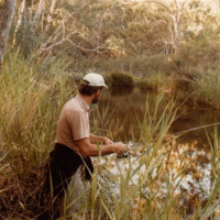 Jim Hanley pictured fishing in the river, [n.d].