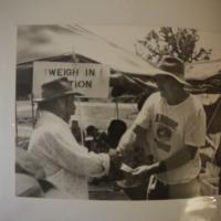 A member from the Narrabri Amateur Fishing Club congratulating a man, 1992.