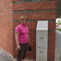 Jenny Shields pictured next to the Seymour flood gauge (VIC), 26 October 2010.