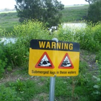A sign warning of snags (submerged logs) in the Condamine River, 2010