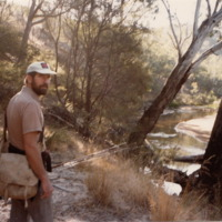 Jim Hanley pictured with his fishing gear, by the riverside, [n.d]