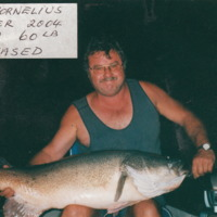 Bob Cornelius pictured with a Murray Cod weighing 60 pounds and measuring 1100 millimetres in length, Easter 2004.