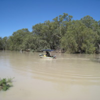 Boating in floodwaters, Darling River, near Pooncarie (NSW), November 2010