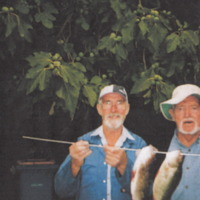 Jim Hanley (L) and Dinga Bell (R) pictured with two Redfin, sized: 1 pound and 14 ounces, and 1 pound nine ounces, Mitchell Creek (VIC), 4 March 2009.