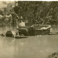A.G. Warner in flooded car, enroute to visit Grace Cooney, 1925