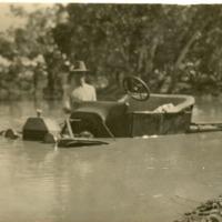A.G. Warner in flooded car, enroute to visit Grace Cooney, 1925