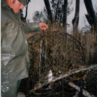John Aston mending a dam net, 1996