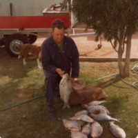 John Aston with fish catch, Murray River, 1979