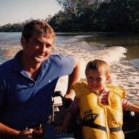 Phillip Parnaby on river with child [1990]