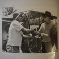 A member of the Narrabri Amateur Fishing Club congratulating a man, 1992.