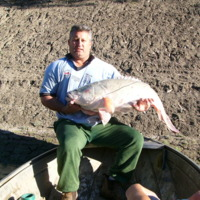 Dwayne Willoughbys father in law Troy. The fish appears to show evidence of a a parasite. Little sores are visible, 2006