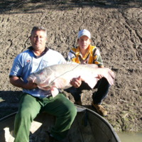 Dwayne Willoughbys brother in law Troy, and Troys son. The fish appears to show evidence of a parasite. Little sores are visible, 2006