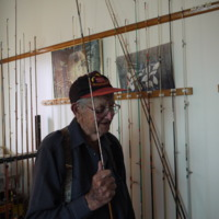 Lyall Hogg with some fishing rods, 2011
