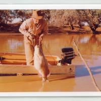 Ron Heinemann with Murray Cod, Caiwarro waterhole, Queensland, 1960