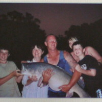 Jody Liversidge and family with a Murray Cod weighing 35 kilograms, Goulburn River near Shepparton (VIC), 23 January 2006.