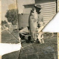 Robert and Leslie Worboys, 30 lb Murray Cod, circa 1960