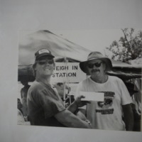 A member of the Narrabri Amateur Fishing Club with a man holding his prize, 1992.
